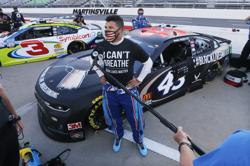 Driver Bubba Wallace is interviewed before a NASCAR Cup Series auto race on June 10 in Martinsville, Va.