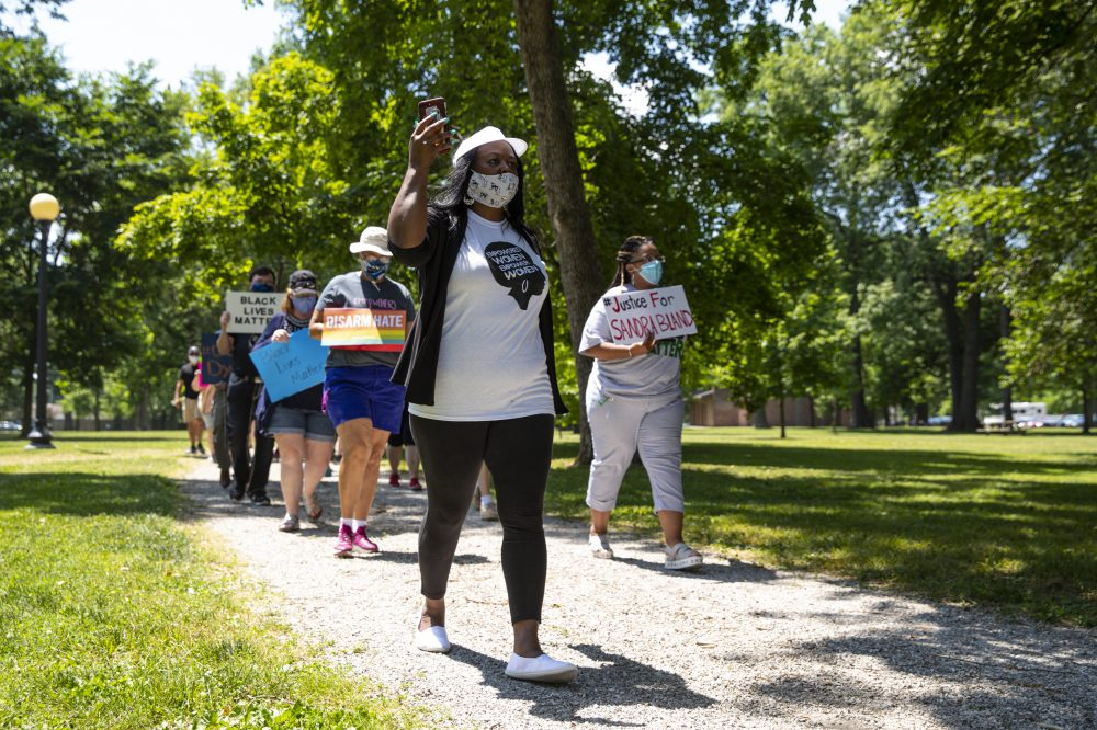 Jeannine Lee Lake, Democratic candidate for Indiana's 6th congressional district, leads a march June 19 to honor George Floyd during a Juneteenth event in Columbus, Ind.