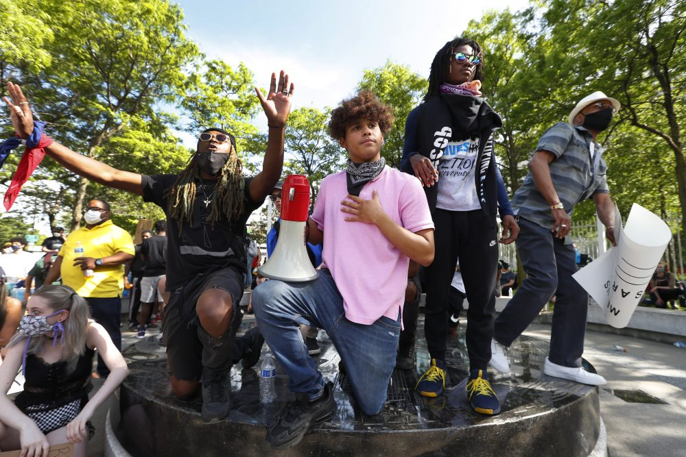 Stefan Perez, second from left, addresses a crowd at a rally June 3 in Detroit over the death of George Floyd.