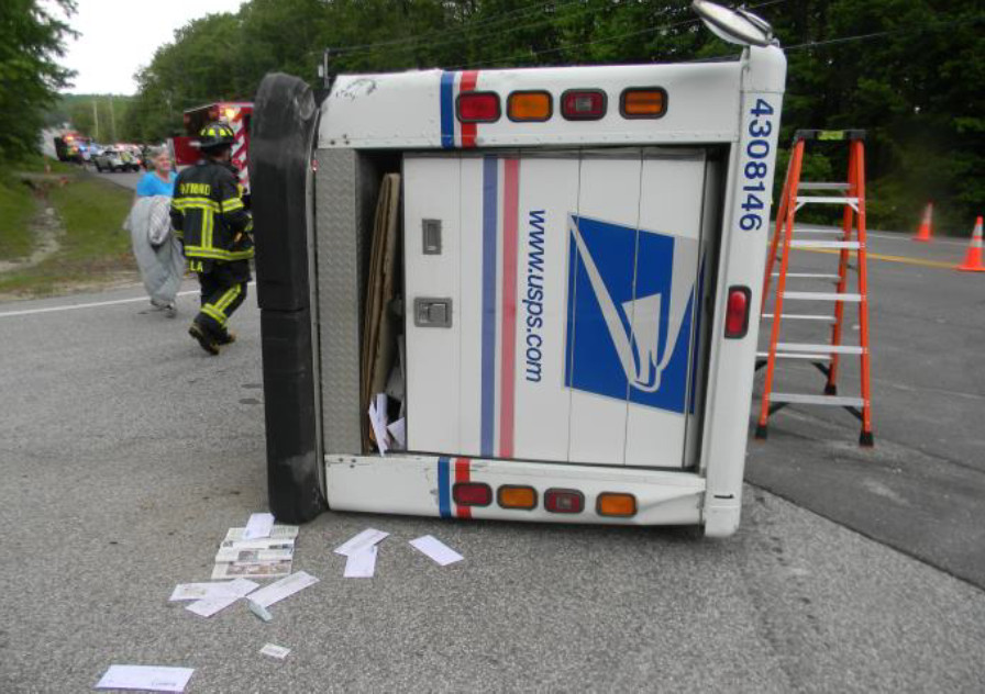 A U.S. postal truck on it's side after a collision in Cumberland County.