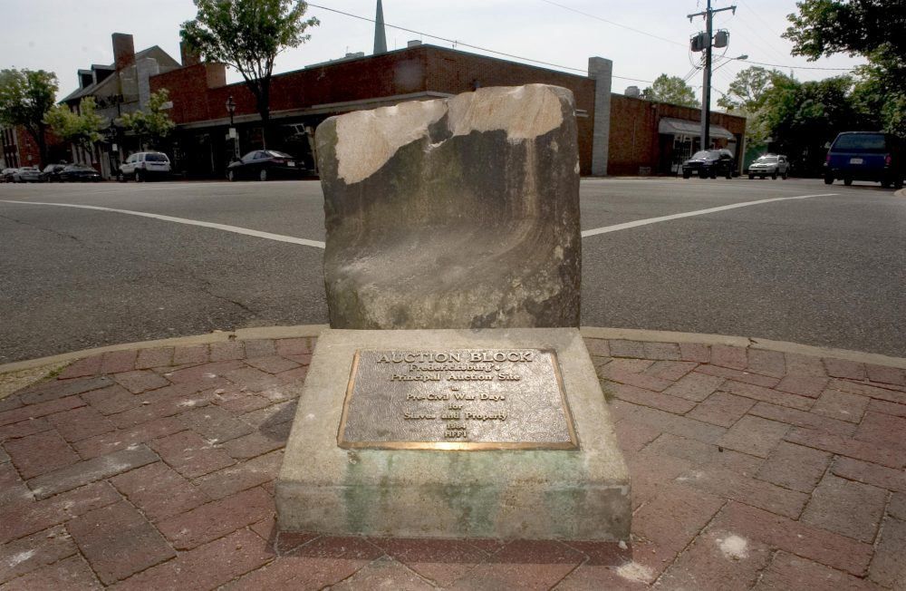 This 2005 photo shows the historic pre-civil war auction block for slaves and property at the corner of Charles and William Streets in downtown Fredericksburg, Va. The 800-pound stone was pulled from the ground early Friday, after its removal was delayed for months by lawsuits and the coronavirus pandemic.