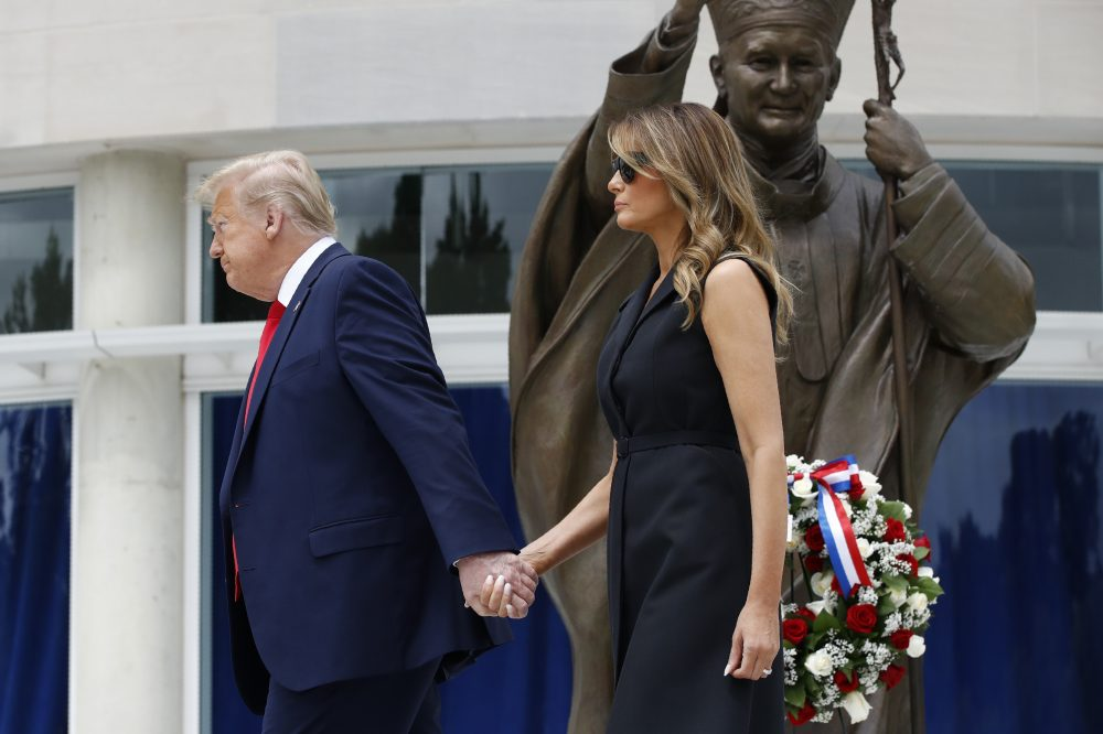 President Trump and first lady Melania Trump depart after visiting Saint John Paul II National Shrine on Tuesday in Washington.