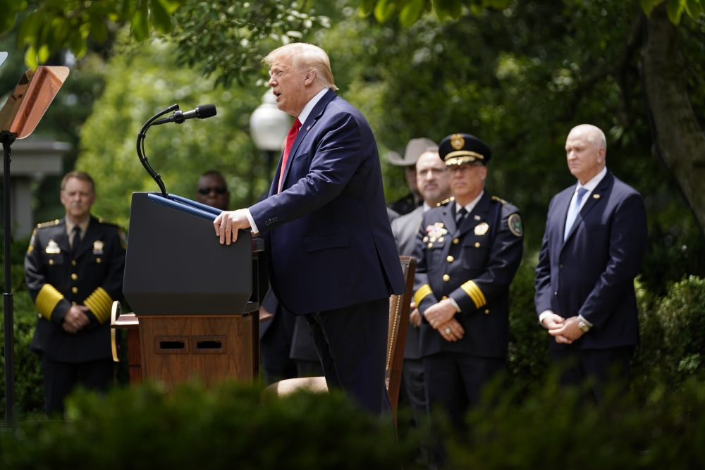 President Trump speaks during an event on police reform in the Rose Garden on Tuesday. Last week, the University of Washington's Institute for Health Metrics and Evaluation published new projections that show COVID-19-related deaths in the U.S. could surpass 200,000 by Oct. 1.