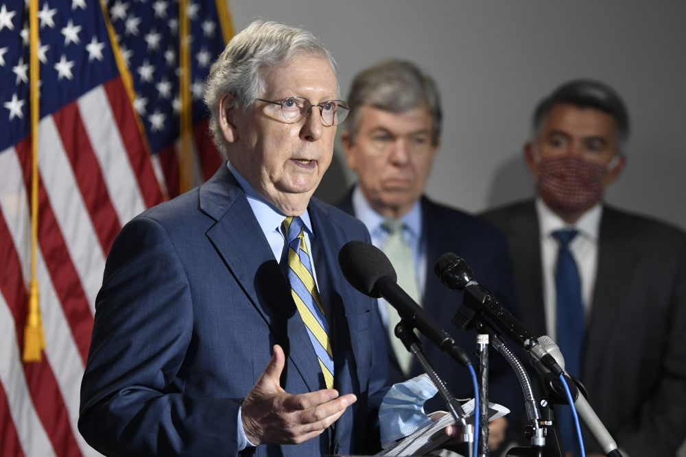 Senate Majority Leader Mitch McConnell of Ky., speaks to reporters after the weekly Republican policy luncheon on Wednesday. Sen. Roy Blunt, R-Mo., center, and Sen. Cory Gardner, R-Colo., right, listen.