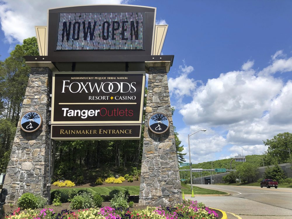 A sign at the entrance to the Foxwoods Resort Casino, in Mashantucket, Conn., announces its June 1 reopening. Both tribal casinos, Foxwoods and Mohegan Sun, closed since March 17, opened despite opposition from Gov. Ned Lamont, who has limited power regarding the sovereign nations.