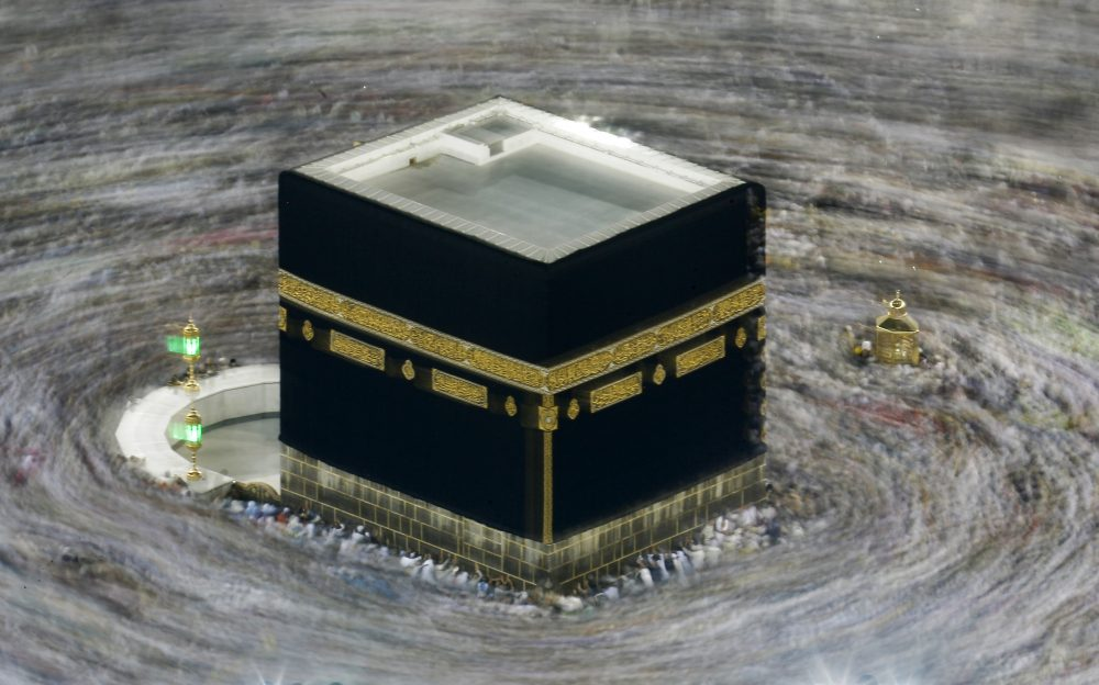 """Taken with slow shutter speed, Muslim pilgrims circumambulate the Kaaba, the cubic building at the Grand Mosque, during the hajj pilgrimage in the Muslim holy city of Mecca, Saudi Arabia, on Aug. 13, 2019. Saudi Arabia says this year's hajj will not be canceled, but that due to the coronavirus only """"very limited numbers"""" of people will be allowed to perform the major Muslim pilgrimage."""