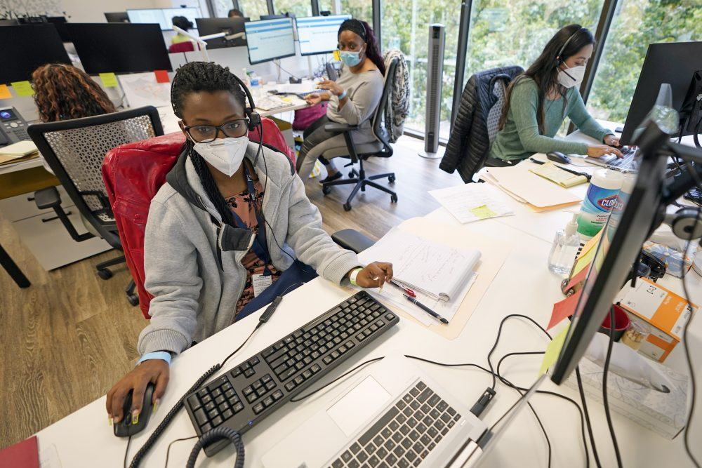 Contact tracers, from left to right, Christella Uwera, Dishell Freeman and Alejandra Camarillo work at Harris County Public Health contact tracing facility on Thursday in Houston. On Monday, the U.S. reported 38,800 newly confirmed infections, with the total surpassing 2.5 million, according to a tally by Johns Hopkins University.