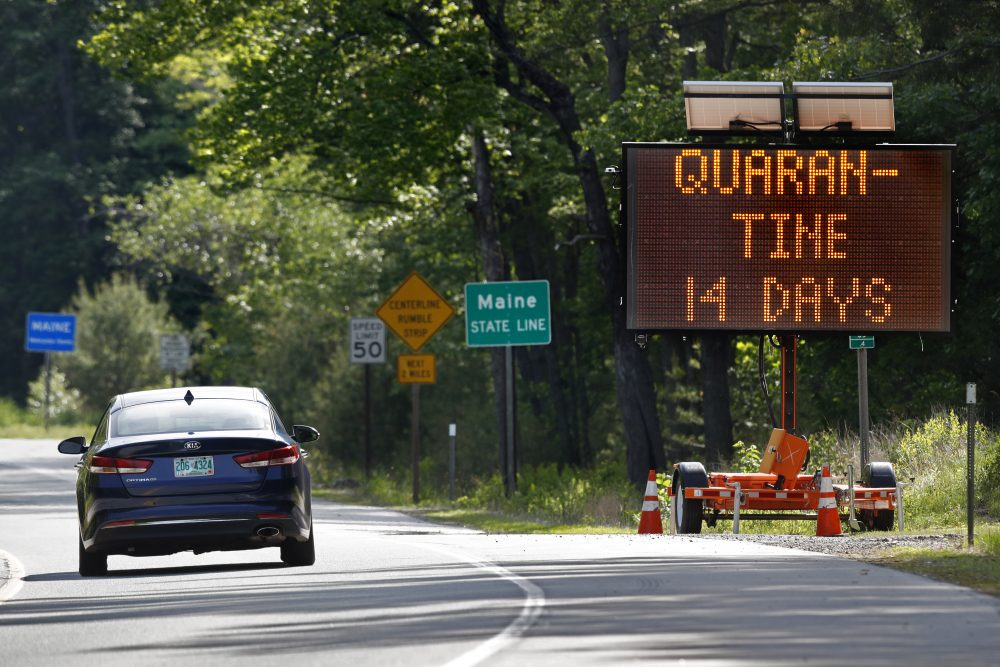 A sign in Gilead, Maine, near the border with New Hampshire, warns visitors entering Maine that they are required to quarantine for 14 days in June of 2020.