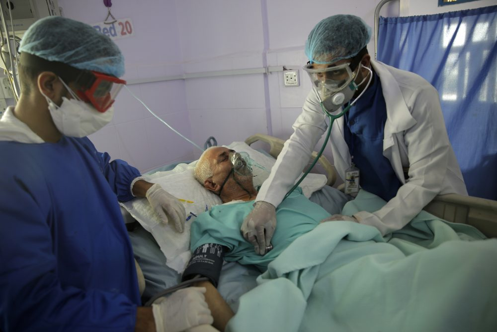 Medical workers attend to a COVID-19 patient in an intensive care unit at a hospital in Sanaa, Yemen, on Sunday. Researchers in England say they have the first evidence that dexamethasone reduced deaths by up to one third in severely ill hospitalized patients.