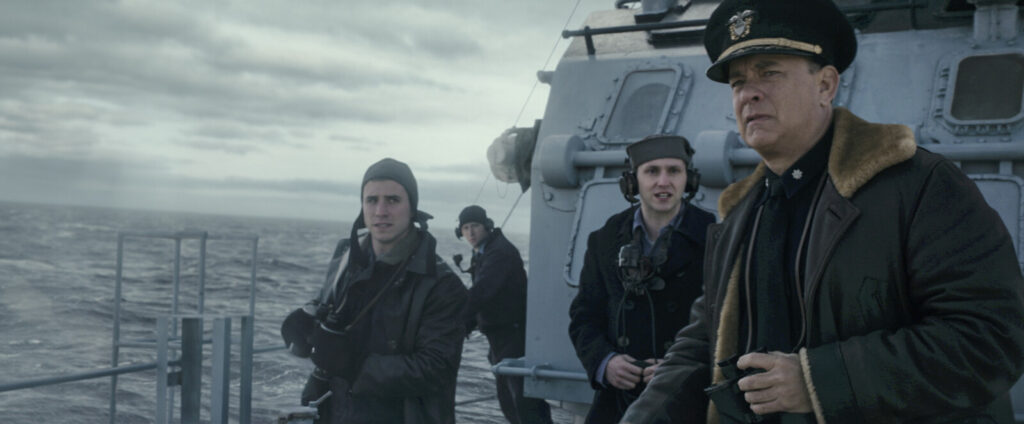 """Capt Krause (Tom Hanks) with crew on the lookout for German U-Boats in TriStar Pictures' """"Greyhound."""""""