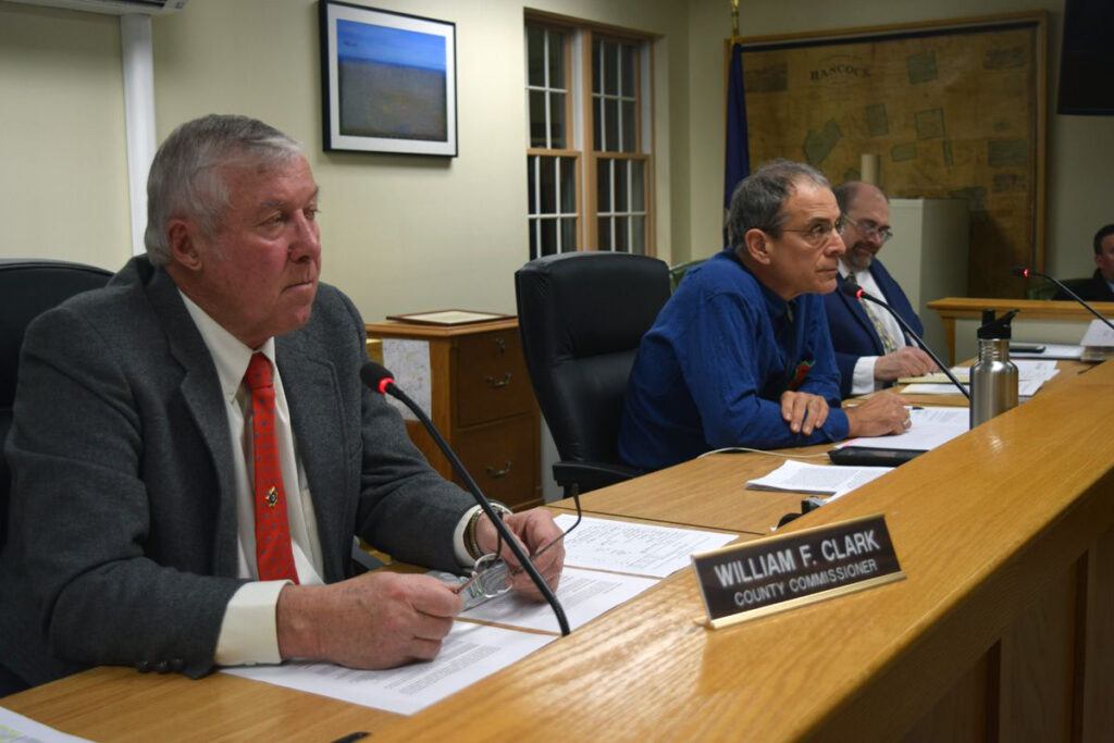 Hancock County Commissioners (from left) Bill Clark, Antonio Blasi and John Wombacher listen to testimony during a 2019 hearing.