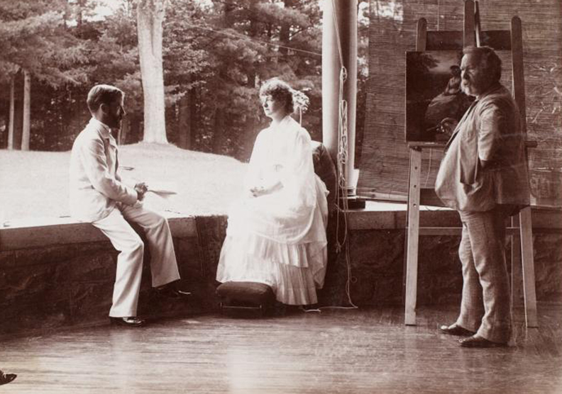 Eastman Johnson making a study for portrait of Katrina Trask while Spencer Trask sits facing her, ca. 1870 - 1910.