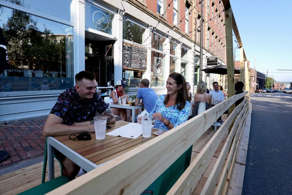 Diners enjoy a newly set-up outdoor dining area, dubbed Camp Hunt + Alpine, on Market Street in the Old Port.