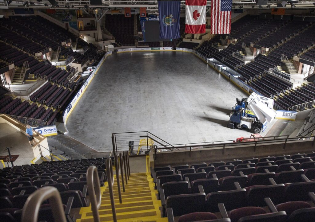 Operations manager Jim Leo at Cross Insurance Arena looks out on an empty floor on July 10 in Portland. Minor league sports franchises including the Maine Mariners, which play at the arena, are in a holding pattern until games can resume safely.