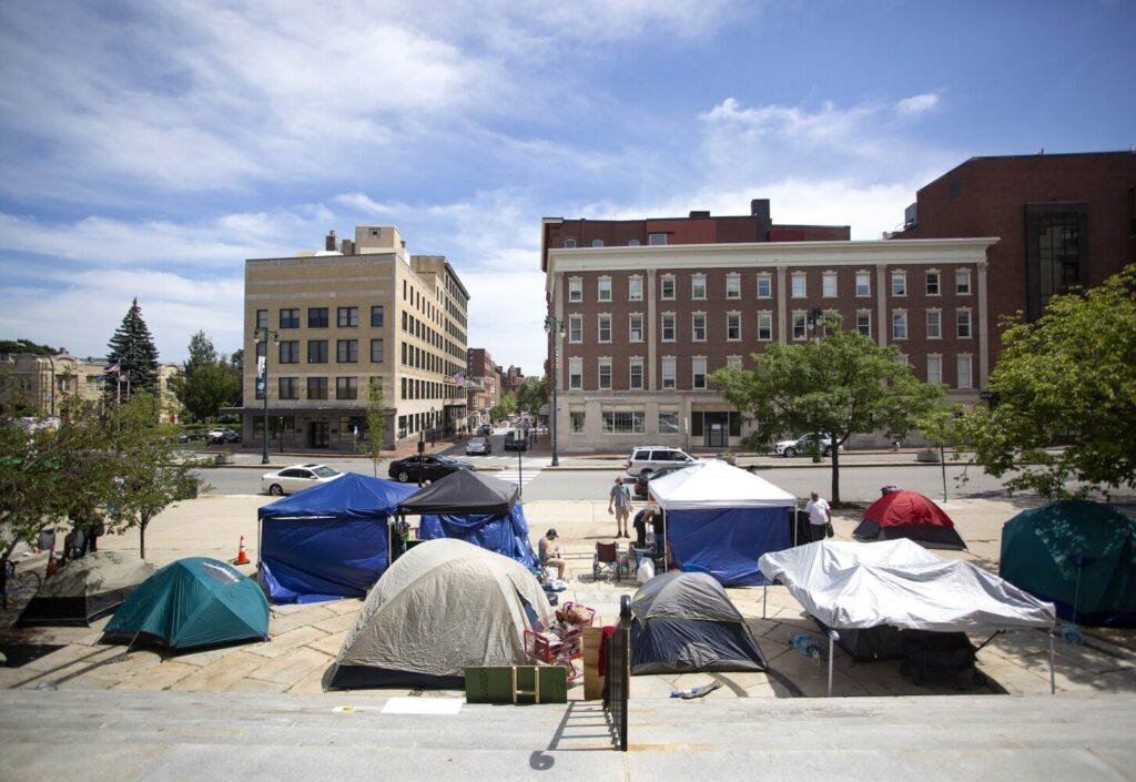 Tents are set up in front of City Hall in Portland, as homeless people and activists continue to use the space for a third day on Friday.