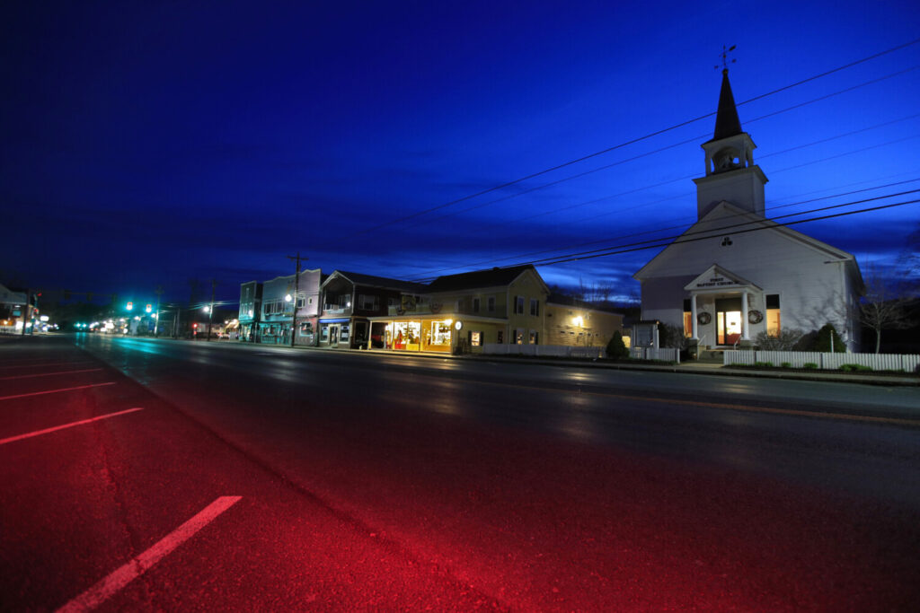 The First Baptist Church and small shops remain closed during the coronavirus pandemic, Sunday, April 26, 2020, in North Conway, N.H. (AP Photo/Robert F. Bukaty)