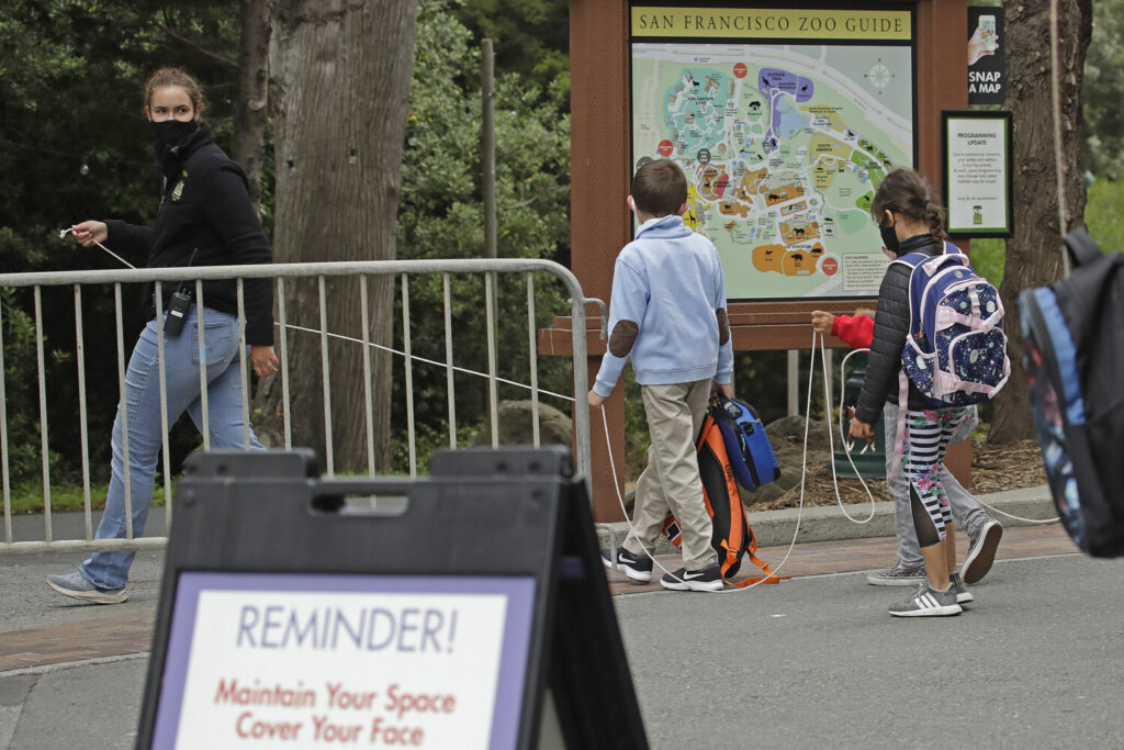 A class keeps social distance at the San Francisco Zoo on Monday in San Francisco.