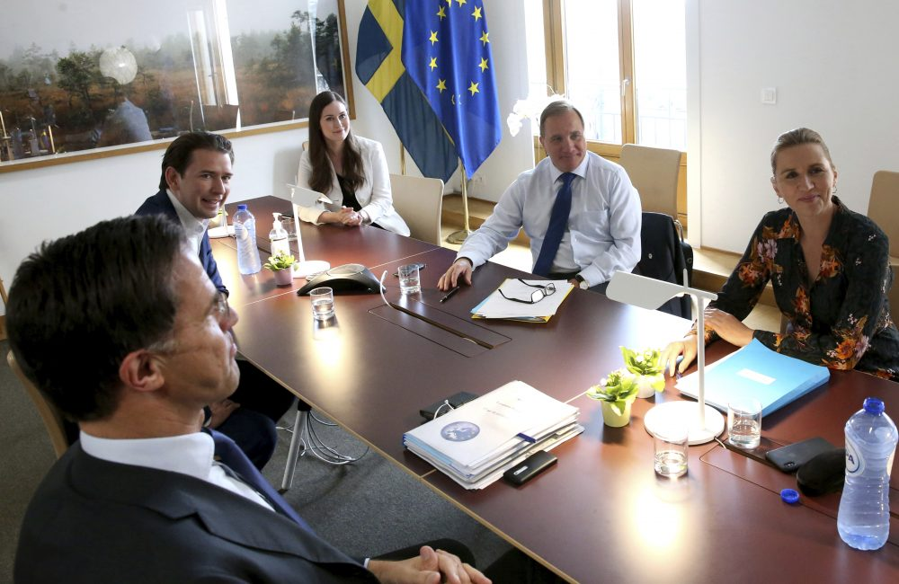 From left, Dutch Prime Minister Mark Rutte, Austria's Chancellor Sebastian Kurz, Finland's Prime Minister Sanna Marin, Sweden's Prime Minister Stefan Lofven and Denmark's Prime Minister Mette Frederiksen meet on the sidelines of an EU summit at the European Council building in Brussels on Sunday.