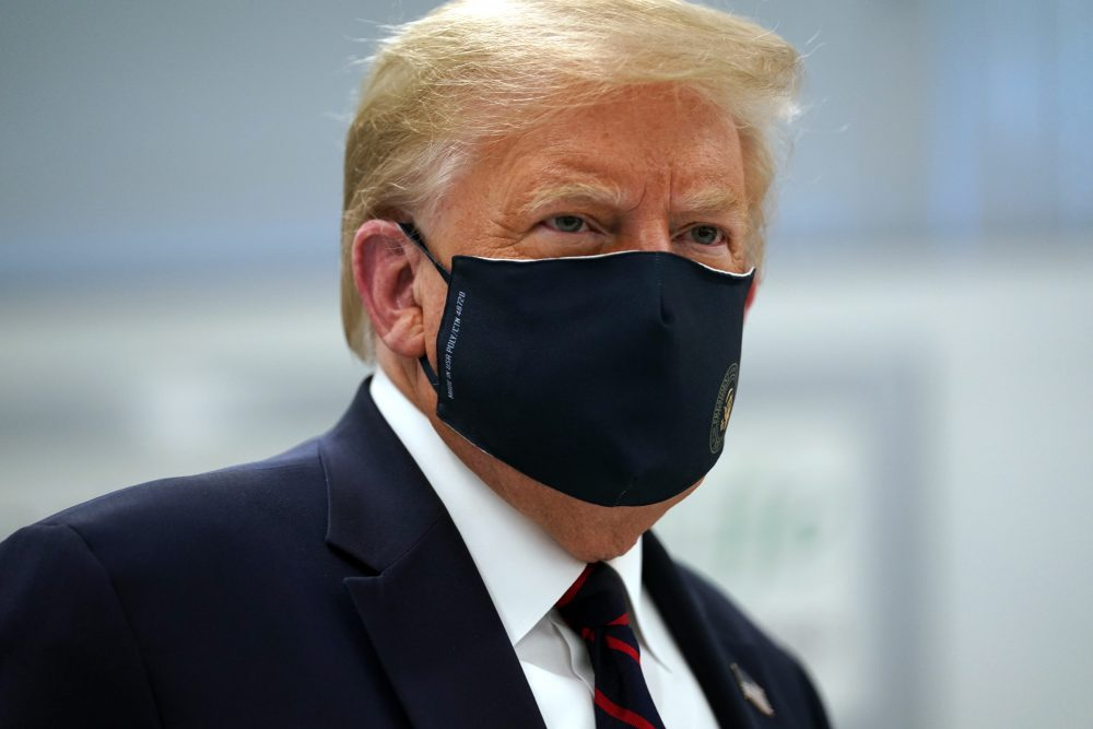 President Trump wears a face mask for the second time in public as he tours the Bioprocess Innovation Center at Fujifilm Diosynth Biotechnologies on Monday in Morrisville, N.C. In addition to sharing the video, Trump retweeted several tweets that attacked the credibility of Dr. Fauci, a leading member of the White House coronavirus task force.