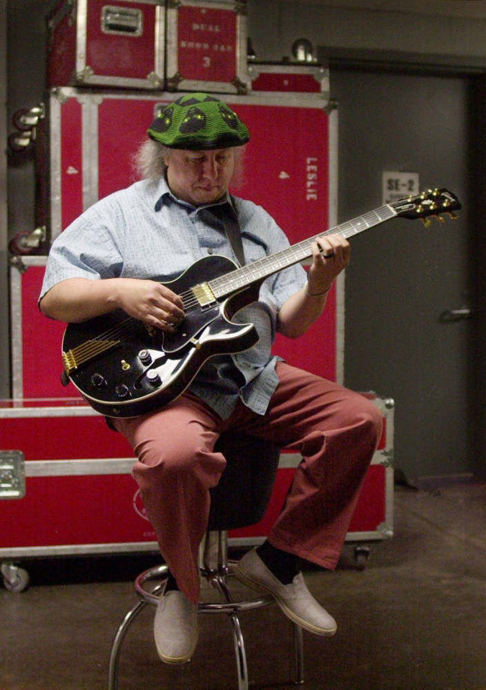 British rock and blues guitarist Peter Green, a founding member of Fleetwood Mac, warms up backstage before performing with his own band, Peter Green's Splinter Group, in 2001