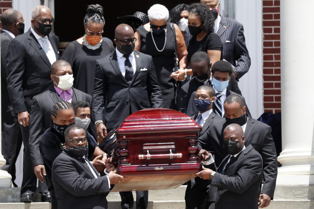 The casket containing the remains of Rev. C.T. Vivian are carried from Providence Missionary Baptist Church after a funeral service Thursday in Atlanta.