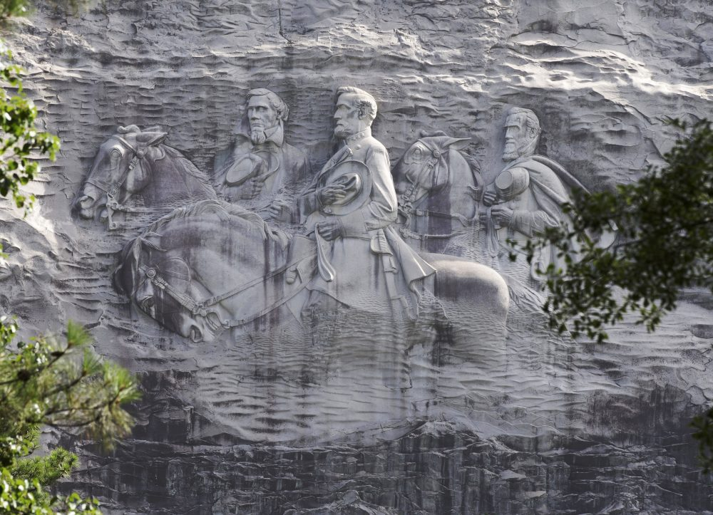 A carving depicting Confederate Civil War figures Stonewall Jackson, Robert E. Lee and Jefferson Davis in Stone Mountain, Ga.