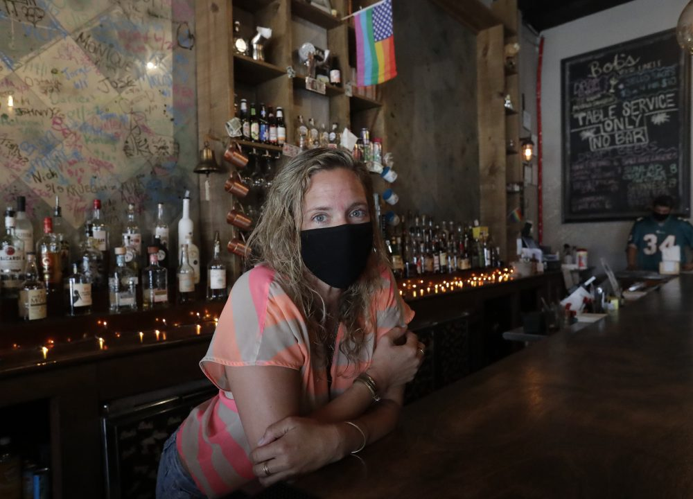 Danielle Savin, co-owner of a bar called Bob's Your Uncle, poses for a photo June 30 at the bar in Miami Beach, Fla. Savin owns two bars that were forced to shut down for months in both New York and Miami Beach.
