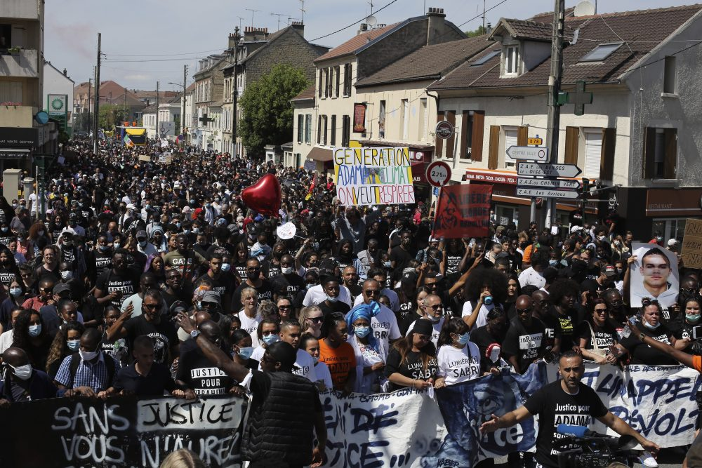 Demonstrators take part in a march to mark the fourth anniversary of the death of Adama Traore, a Black man in police custody, whose case has mobilized broad anger against police brutality and racial injustice, in Beaumont-Sur-Oise, a  suburb of Paris, on Saturday.