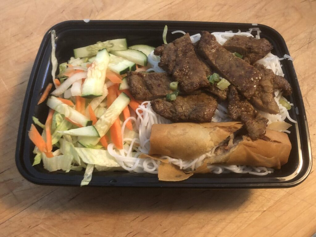 Bun, a rice noodle dish, included roast pork, vegetables and an egg roll, from Taytene Cafe in South Portland.
