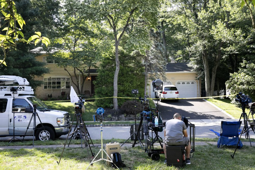 News media is set up in front of the home of U.S. District Judge Esther Salas in North Brunswick, N.J. A gunman posing as a delivery person shot and killed Salas' 20-year-old son and wounded her husband Sunday evening at their home before fleeing, according to judiciary officials.