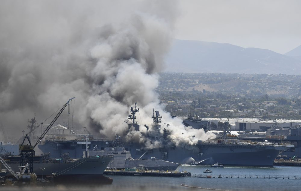 Smoke rises from the USS Bonhomme Richard at Naval Base San Diego Sunday after an explosion and fire onboard. (AP Photo/Denis Poroy)