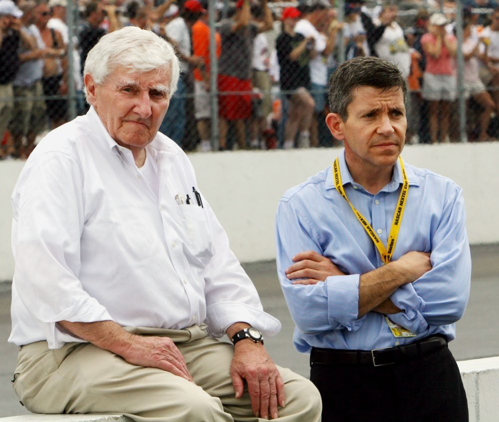 FILE - In this July 17, 2005, file photo, owners of New Hampshire International speedway Bob Bahre, left, and son Gary Bahre wait out a rain delay before a NASCAR Nextel Cup New England 300 at New Hampshire International Speedway in Loudon, N.H. Bob Bahre, who brought NASCAR racing to New England at the New Hampshire International Speedway, has died at his home in Maine at 93. (AP Photo/Jim Cole, File)
