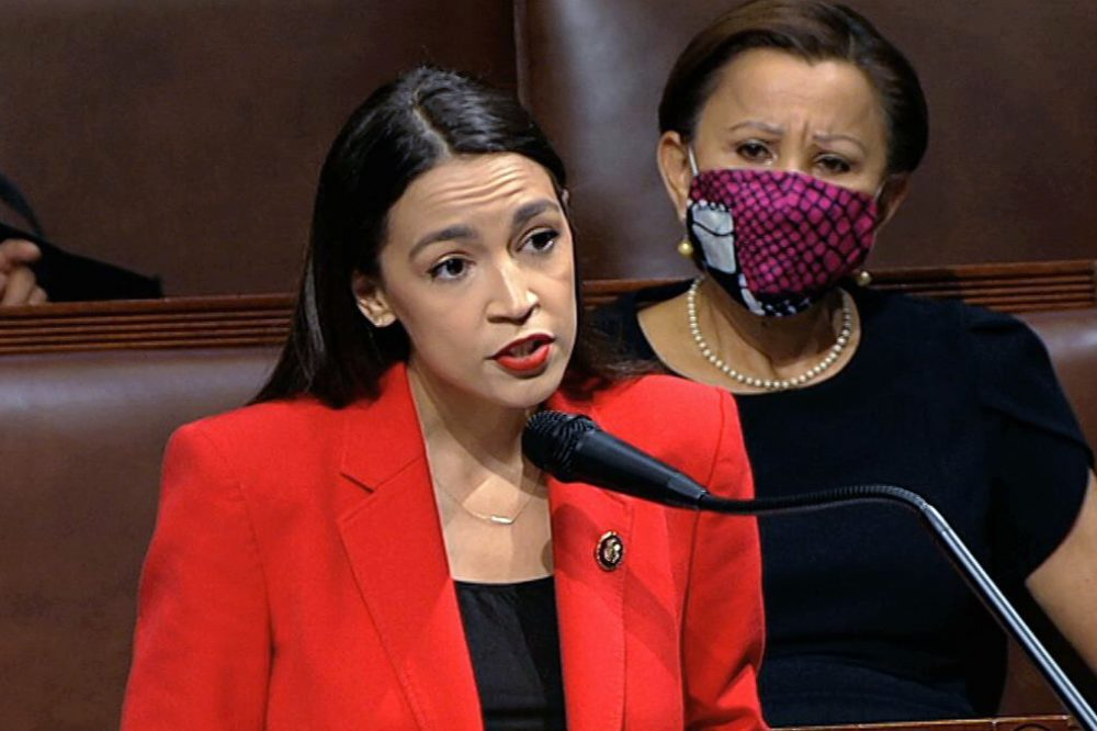 In this July 23 image from video, Rep. Alexandria Ocasio-Cortez, D-N.Y., speaks on the House floor on Capitol Hill in Washington. Rep. Nydia Velázquez, D-N.Y., is seated at right.