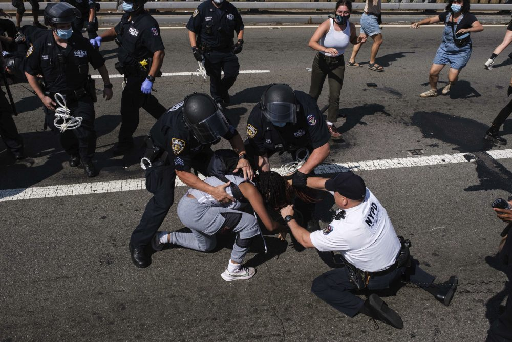 Black Lives Matter protesters are arrested by New York police officers on the Brooklyn Bridge on July 15.