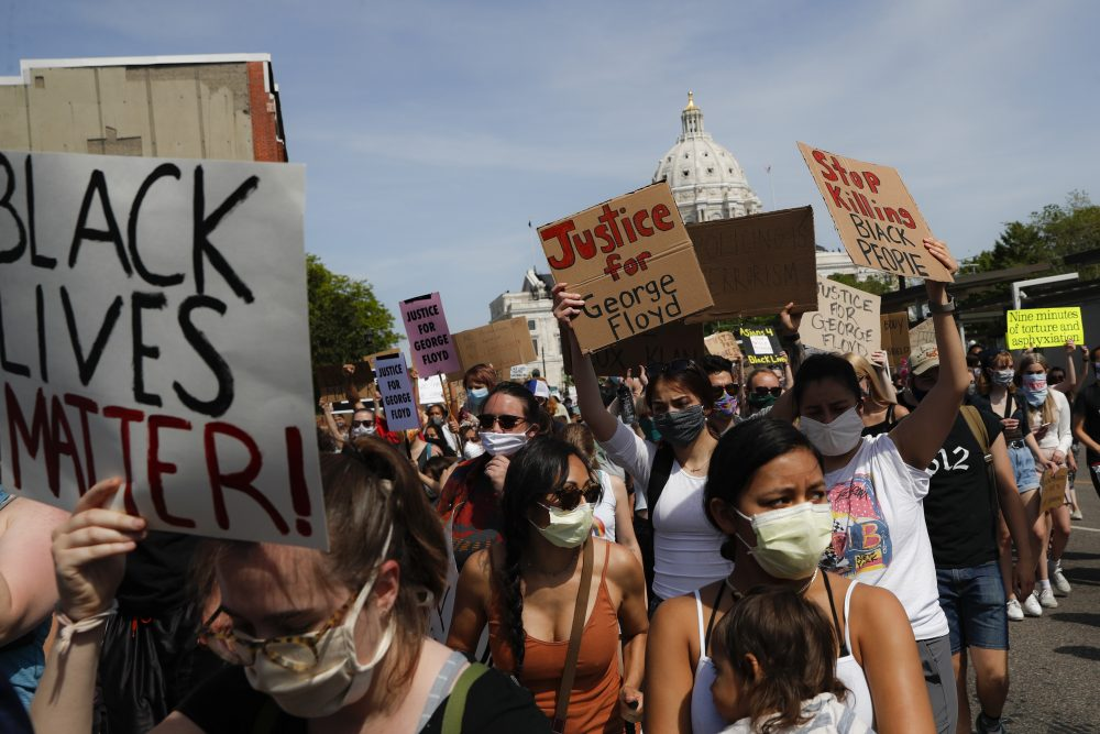 Protesters march away from the State Capitol on May 31 in St. Paul, Minn.