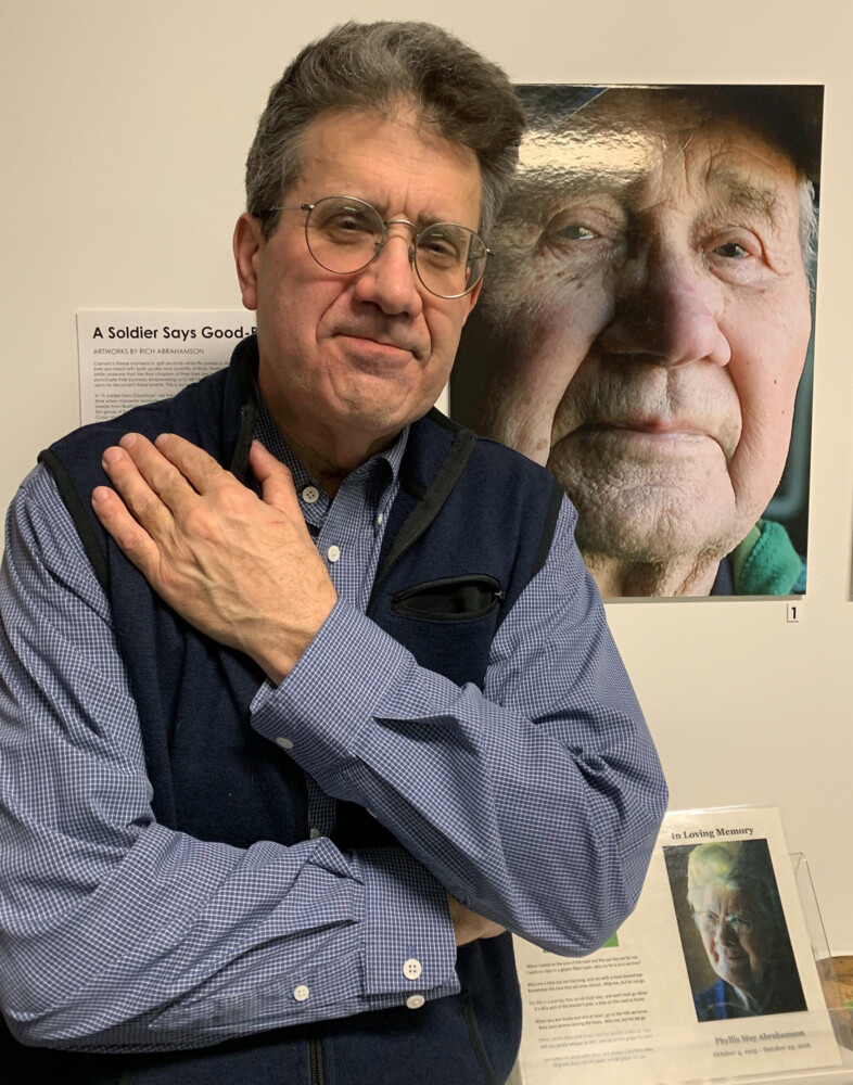"""Rich Abrahamson with his exhibit """"A Soldier Says Goodbye."""""""