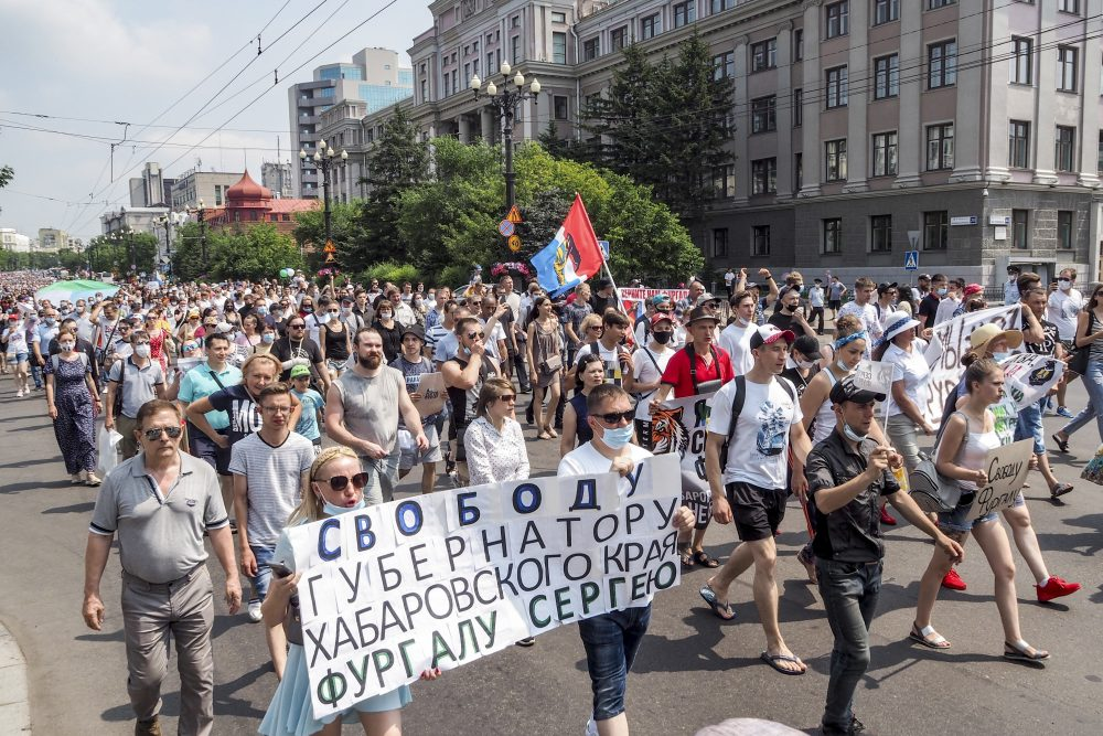 """People hold posters that read: """"Freedom for Khabarovsk region's governor Sergei Furgal"""" during an unsanctioned protest in Khabarovsk Russia, on Saturday"""