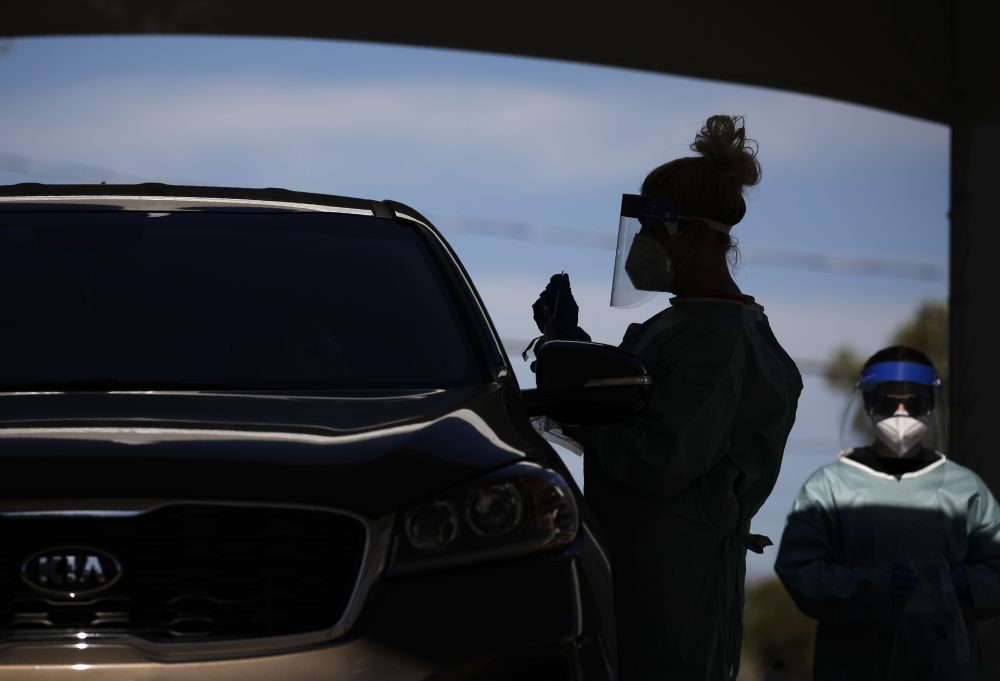 Healthcare workers test patients in their cars at a drive-thru coronavirus testing site in Las Vegas earlier this month. Three Russian websites have leveraged the pandemic to promote anti-Western objectives and to spread disinformation.