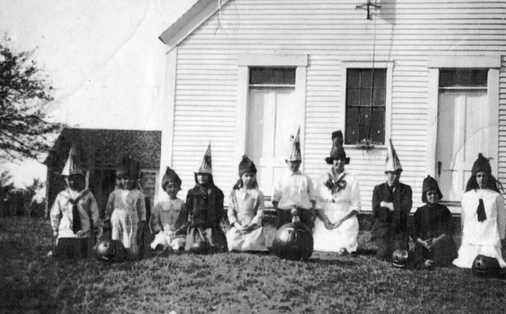 These Shepherd School students in the class of 1930-31 show off their home-made hats for Halloween. The Shepherd School was off the Mountain Road and one of the 17 one-room schoolhouses that served Jefferson students over the years. The only students identified are Robert Madden (3rd from the right) and his sister Frances (3rd from the left).
