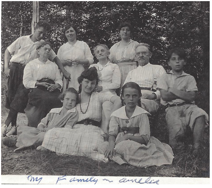 """Photo: Todd R. Nelson family archives. Center, seated: Amelia Behrhorst with her cousins, brothers, grandparents, aunt and mother. She labeled the photo """"my family."""""""