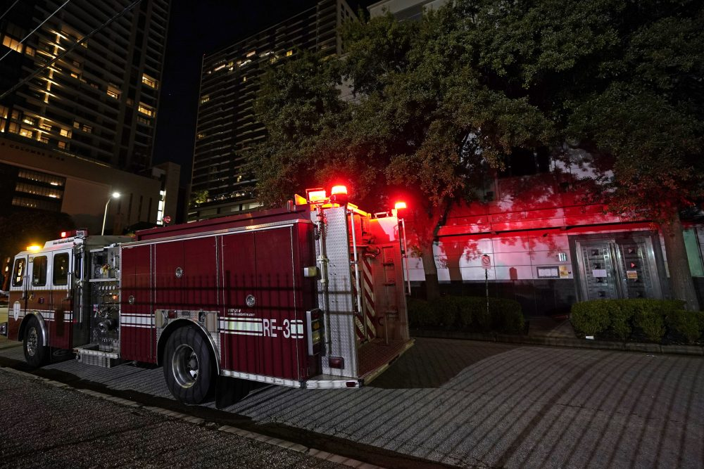 A firetruck is positioned outside the Chinese Consulate Wednesday in Houston. Authorities responded to reports of a fire at the consulate. Witnesses said that people were burning paper in what appeared to be trash cans, according to police. China says the U.S. has ordered it to close its consulate in Houston in what it called a provocation that violates international law.