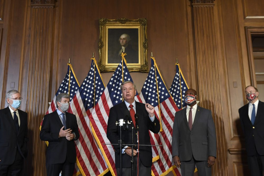 Sen. Lindsey Graham, R-S.C., center, speaks during a news conference on on Capitol Hill in Washington on Monday to highlight the Republican proposal for the next coronavirus stimulus bill. Joining Graham, from left, is Senate Majority Leader Mitch McConnell of Ky., Sen. Roy Blunt, R-Mo., Sent. Tim Scott, R-S.C., and Sen. Richard Shelby, R-Ala.