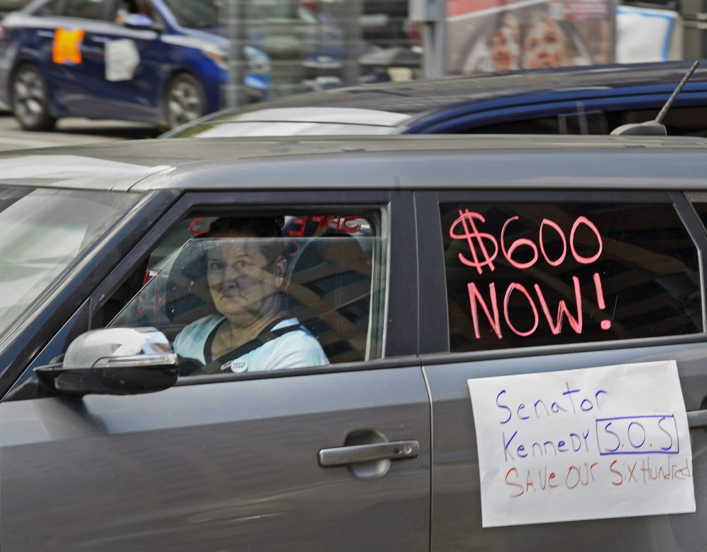 Motorists take part in a caravan protest asking for the extension of the $600 in unemployment benefits to people out of work because of the coronavirus Wednesday in front of Senator John Kennedy's office at the Hale Boggs Federal Building in New Orleans, La.