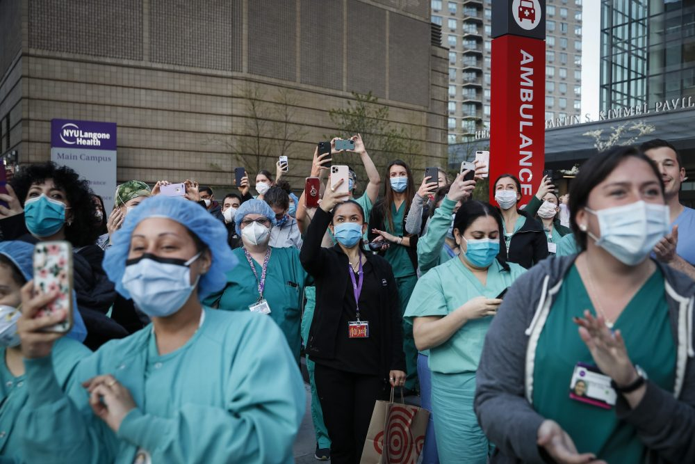 Medical personnel attend a daily 7 p.m. applause in their hono April 28 during the coronavirus pandemic outside NYU Langone Medical Center in the Manhattan borough of New York.