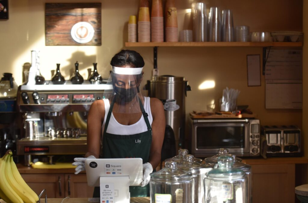 Lily Damtew, owner of Abyssinia Market and Coffee House reopened her small business in Alexandria, Va., on Saturday. Damtew was assaulted by a maskless man who spat at her feet and hurled chicken and rice at her window when she asked him to cover his face before entering her shop.