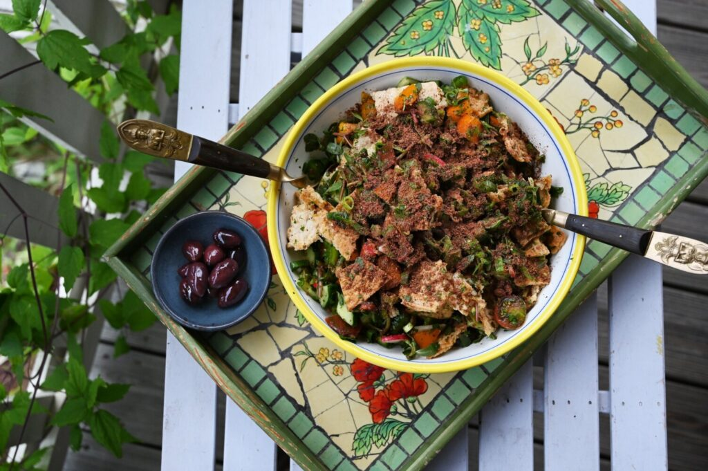Fattoush, a classic Middle Eastern salad, is sprinkled with sumac just before it's served. Goronson Farms is selling local sumac.