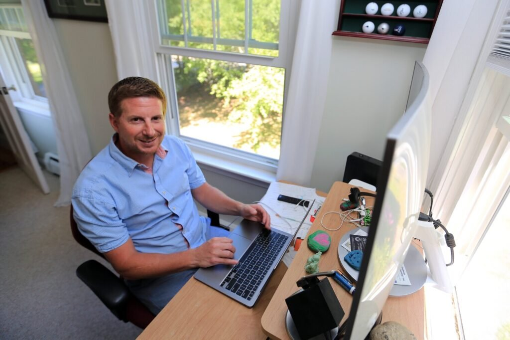 Brian Karbel of Scarborough has been working remotely from his home for years. Many Maine companies that normally have employees work from an office are extending remote work at least through the end of the year because of the coronavirus pandemic, and most workers are happy about it.