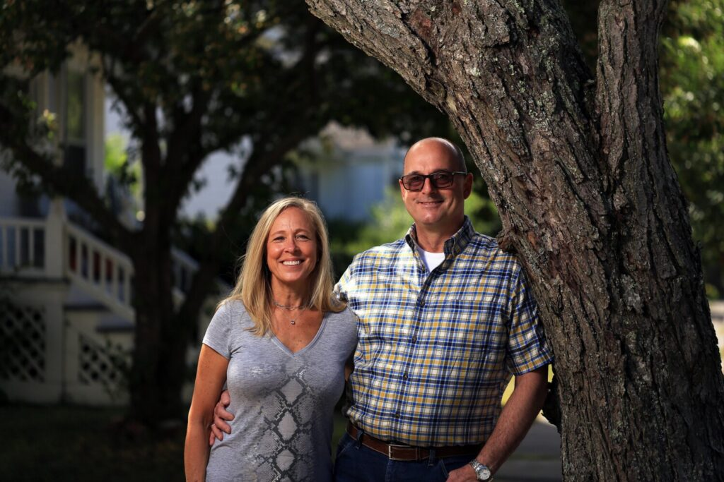 David and Janet Gilmore stand outside their rental apartment in Portland's Deering neighborhood on Friday. The Gilmores are gearing up to move to a new house in Hollis. Home sales rebounded in July, as did the median price of homes. Analysts say there's high demand and a lack of inventory.