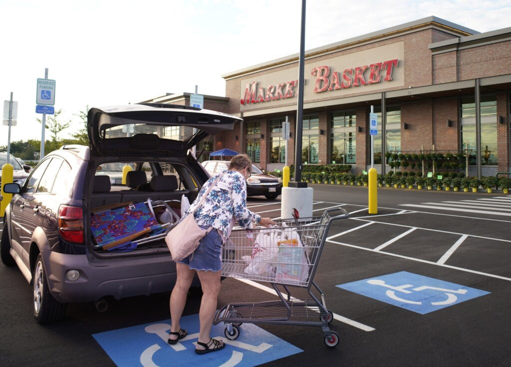 Nancy Profenno of Portland loads a car with groceries after shopping at Market Basket in Westbrook on the grocery store's opening day on Friday. Profenno said she had been shopping at the Market Basket in Biddeford and is glad to have one closer to Portland.