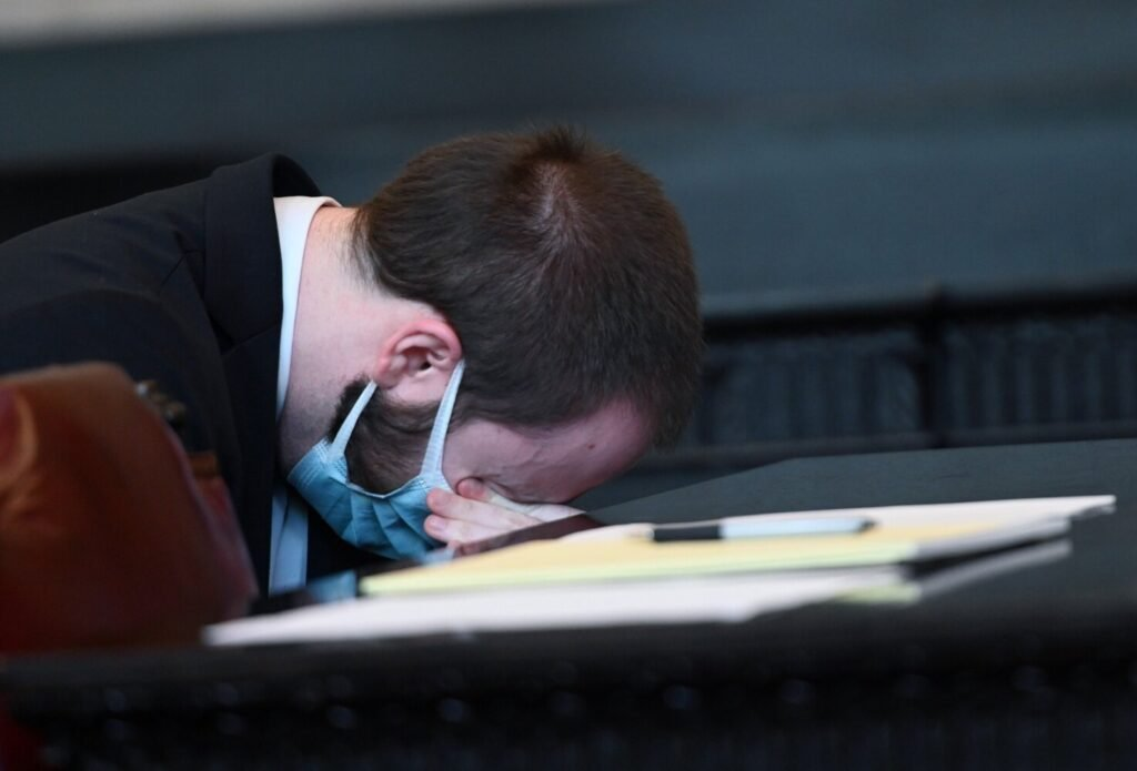Mark Cardilli Jr. puts his head down and wipes his eyes after his sister Chelsey Cardilli spoke during his sentencing at the Cumberland County Courthouse on Monday.